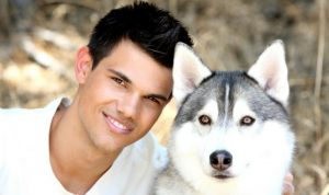 Taylor Lautner with his husky