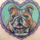Heart-shaped english bulldog tattoo