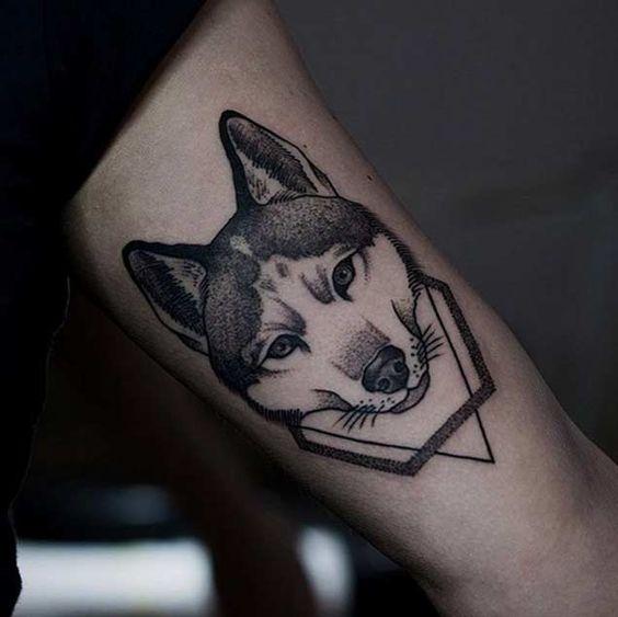 Beautiful geometric husky tattoo design