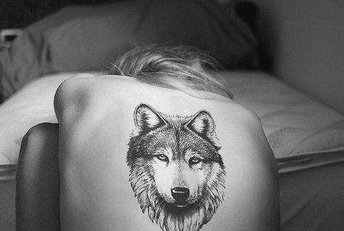 Husky tattoo on back