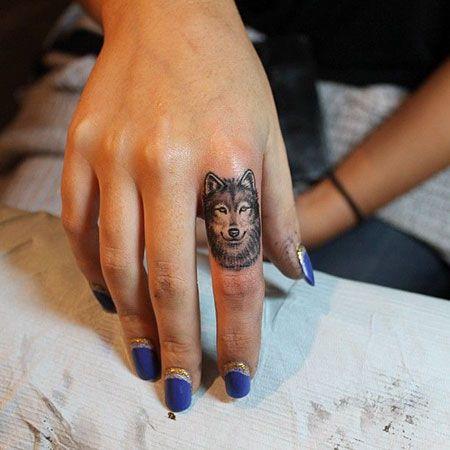 Finger husky tattoo design