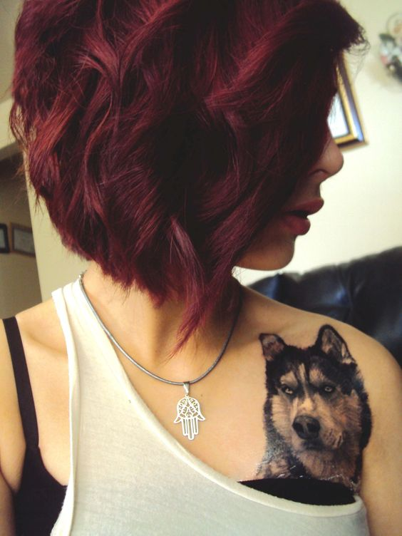 Beautiful husky tattoo on shoulder