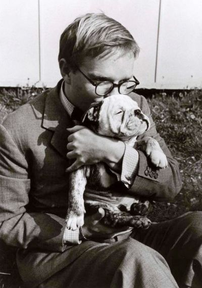 Truman Capote kissing his beloved bulldog