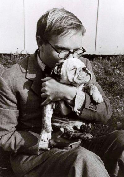 Truman Capote kissing his beloved bulldog