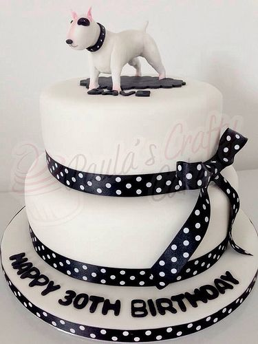 Ribbon cake with a bull terrier figure
